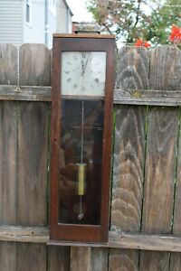 antique electric / battery electric impulse clock with cylinder pendulum