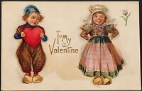 Valentine Postcard ~ Dutch Boy Holds Large Red Heart While Looking At Dutch Girl