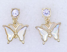 Very pretty rainbow sparkle effect butterfly earrings hanging down from crystal