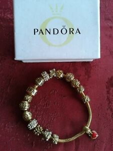 PANDORA gold tone bracelet with 15 gold and diamante charms 1 red enamel heart