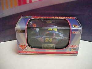 1999 JEFF GORDON #24 DUPONT SUPERMAN 1/64 REVELL CAR