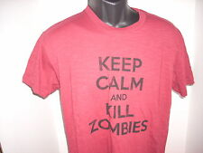 WORLD WAR Z PRIZE PACK 2 THEATRICAL SHIRTS NEVER USED OR WORN PLUS A FIRST AID