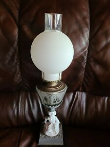 ANTIQUE VICTORIAN CUT GLASS OIL LAMP ON A FIGURAL BASE OF GIRL AND DOG SHADE