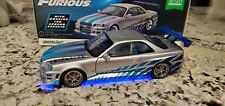 1:18 Fast Furious Brian's 1999 Nissan Skyline GT-R R34 Greenlight with blue glow