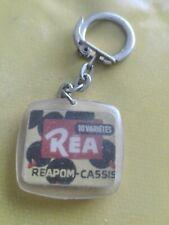 porte-clés Réa, jus de fruits reapom-cassis (pc)