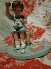 """Little Mother"" Danbury Mint Figurine.Little Girl Sewing for Doll.Sweet"