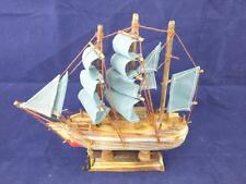 Simple Wooden Sailing Boat with Blue Sails Ornament.