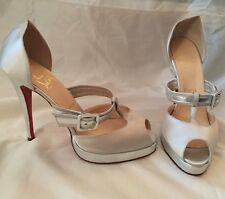 Christian Louboutin platform satin and silver heels
