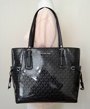 8bf44009dc8f Michael Kors Voyager East West Signature Glossy Tote in Black Silver