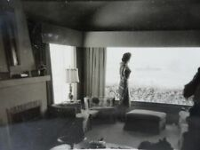 Busty Silhouette Woman Looking Out Giant Window Overlooking Ocean Snapshot Photo