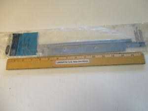 """NEW UNOPENED OEM FORD 1991/1996 ESCORT & TRACER """"RAIL"""" ROOF PANEL CABLE GUIDE"""