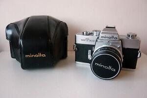 Minolta SRT 303 with lens and case.