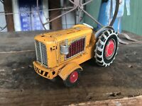 VINTAGE--CRAGSTAN--MADE IN JAPAN--PRESSED TIN FRICTION TOY TRACTOR