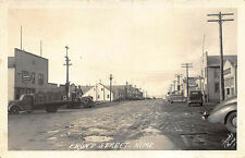Nome AK Dirt Front Street Store Fronts Trucks Signed Jacobs RPPC Postcard