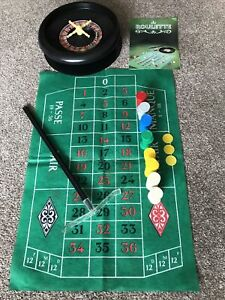 Vintage Casino Roulette Wheel With Croupier Rake, Chips And Playing Surface