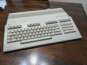 commodore 128, 1571 disk drive, psu, many disks and manuals etc. tested working