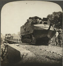 WW I STEREOVIEW TANKS ROLLING DOWN THE ROAD.