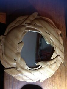 solid walnut  carved wood Dolphin mirror 30 cms diameter