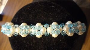 Handmade bracelet with faux pearls, light blue crystal beads & clear seed beads.