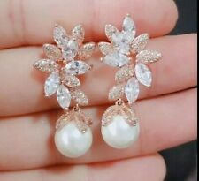 Rose Gold Plated Earrings With Cubic Zirconia And Dangling Pearl