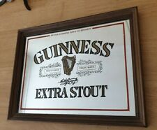 VINTAGE GUINNESS EXTRA STOUT MIRROR IN WOODEN FRAME.