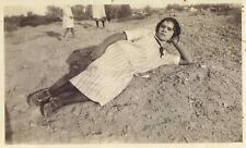 Vintage Old 1930's Photo of Mexican American Girl lying on the Ground in Dirt