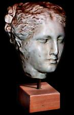 Ancient Greek sculpture Hygeia daughter Asclepius and Epione. On a timber stand.