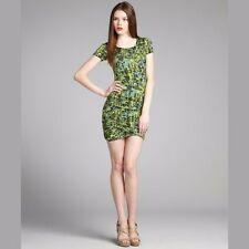 BCBG Very flattering and stretchy BCBG dress with unique green print.