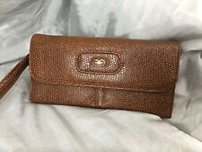 Brown faux leather textured clutch bag with wrist strap