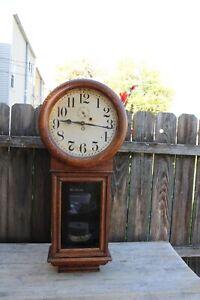 new haven clock co. 8 day weight driven wall regulator clock ,Saturn model .