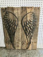 Angel wings on reclaimed wood