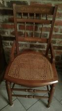 Antique chair with hand caned seat bottom