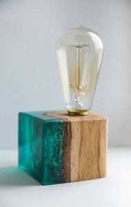 Big emerald Epoxy resin lamp with oak trunk