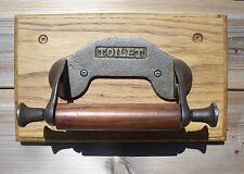 Antique style hand cast iron toilet holder with hardwood holder on oak board