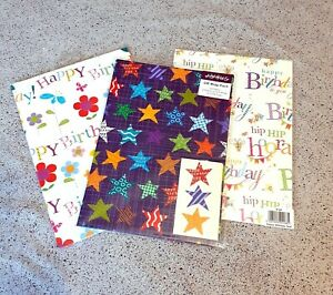 Gift Wrap Pack 2 Sheets with 2 Gift Tags Stars Hip Hip Hooray Flowers Abacus