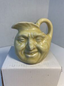 small vintage moon face pitcher yellow