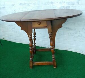 Vintage Brandt Small Drop Leaf Oval Table With Drawer