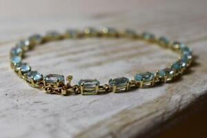 11.00 Ct Oval Cut Blue Topaz Vintage Tennis Bracelet With 14K Yellow Gold Finish