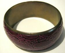 Fantastic bangle style bracelet with purple faux snake skin pattern exterior