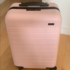 New in Box Away Travel Luggage The Bigger Carry-On w/ Battery in Pink