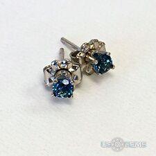 14 K. White gold 3 mm Round natural Topaz London Blue Stud Earrings. US@GEMS