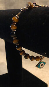 Eye Catching!  Brass & Gold Tones Tigers Eye Beaded Bracelet W/ Evil Eye Charm
