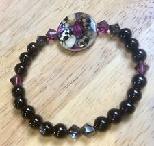 GOTHIC AND GIRLIE, WITH SWAROVSKI CRYSTALS, SHELL BEAD, SKULLS,ROSES, AND AGATE