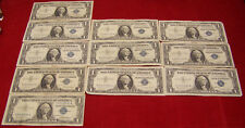 11 1957 $1 Silver Certificates - various #'s - VF