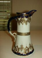 Vintage Nippon tall pitcher with hand paint blue and gold lace design Rare