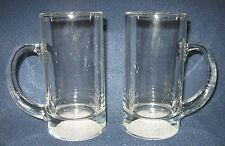 "LOT OF 2 CLEAR GLASS MUGS WITH GOLF BALL IMPRINT IN BASE - APPROX 6"" TALL"