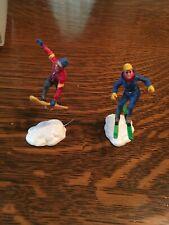 vinatge Lemax skiing/ snowboarding (2) figurines Vail Village?