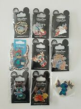 Lot de 9 Pin's DISNEY STITCH (acteur, barbosa, noël, ange et démon...)