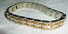 Silver & gold colored bracelet with rhinestones like a tennis bracelet 8 inches