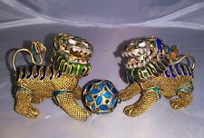 Pair of Chinese sterling silver and enamel gilded foo dogs